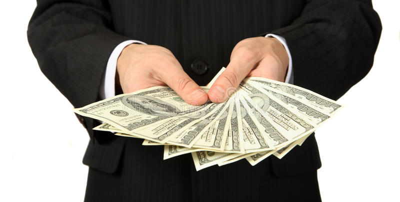 Pengarna i hand royaltyfri foto