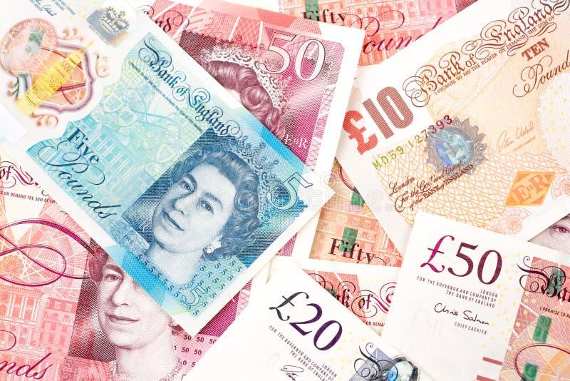 Pengarräkningar för brittiskt pund av Förenade kungariket i olikt värde royaltyfri foto