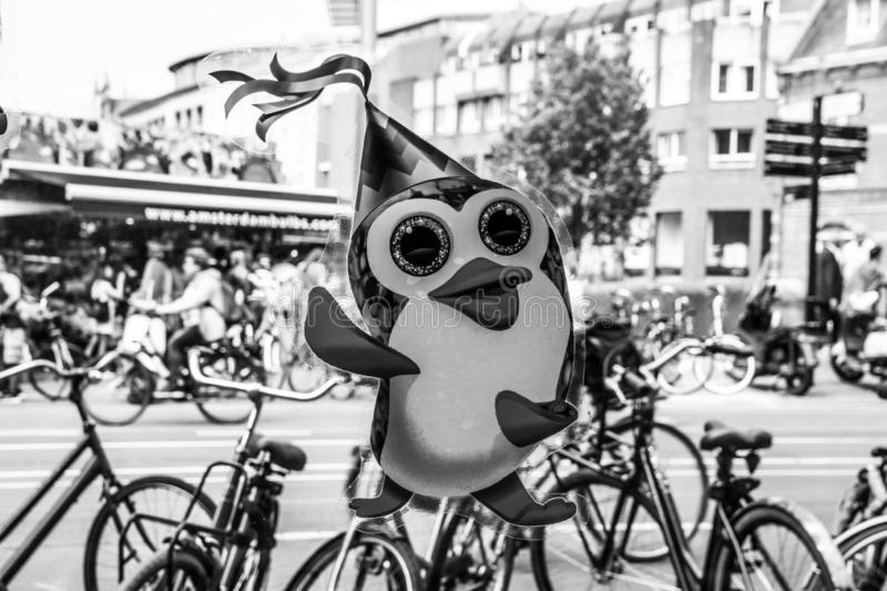 Penguin Sticker On A McDonalds Restaurant Window At Amsterdam The Netherlands 2019 In Black And White stock photography