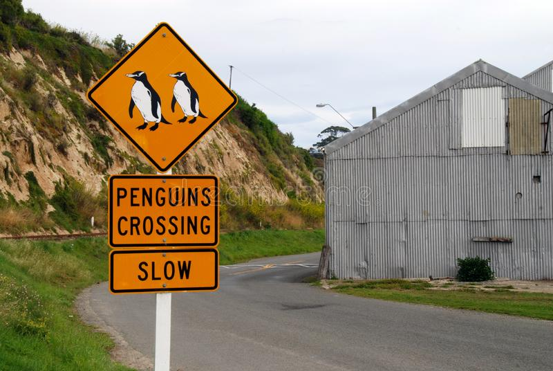 Penguins crossing traffic sign stock photography