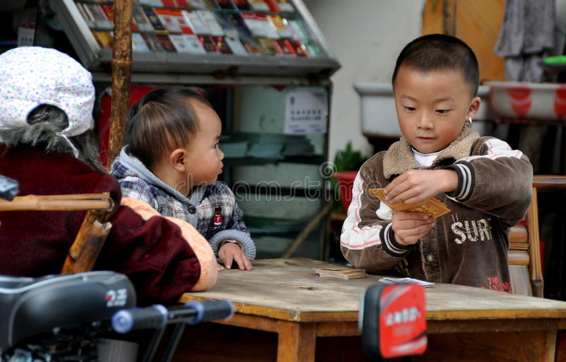 Pengzhou, China: Boy Playing Cards