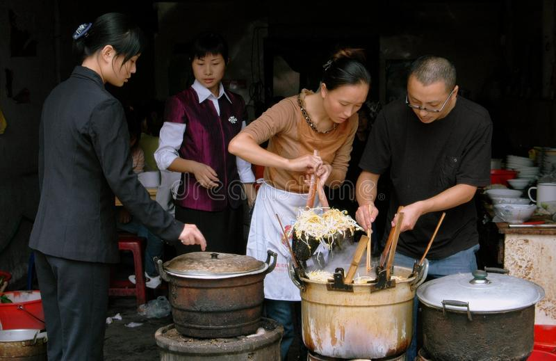 Pengzhou, China: Cooks at Restaurant stock photos