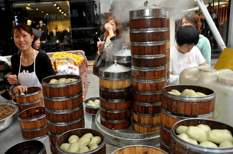 Pengzhou, China: Family Selling Steamed Dumplings Editorial Image