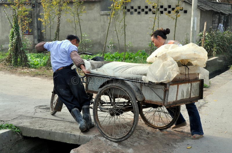 Download Pengzhou, China: Farmers Pushing Cart Editorial Photo - Image: 22194861