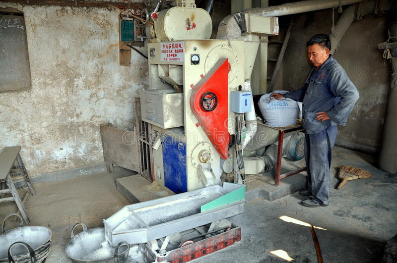 Pengzhou, China: Man Processing Rice