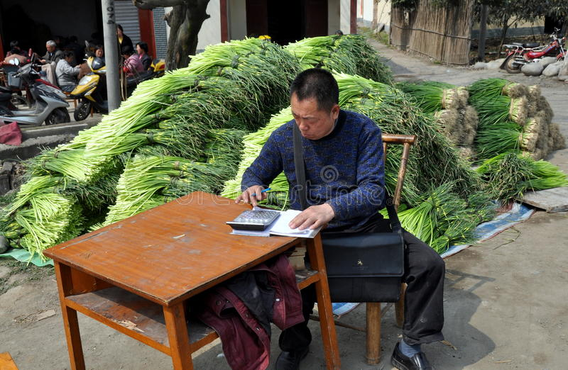 Pengzhou, China: Man Using Calculator stock photos
