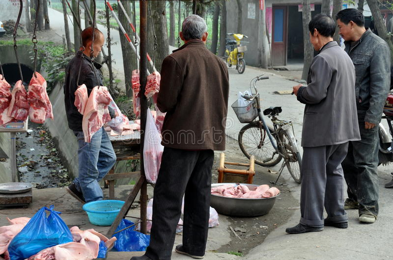 Pengzhou, China: Men Buying Pork Editorial Photography
