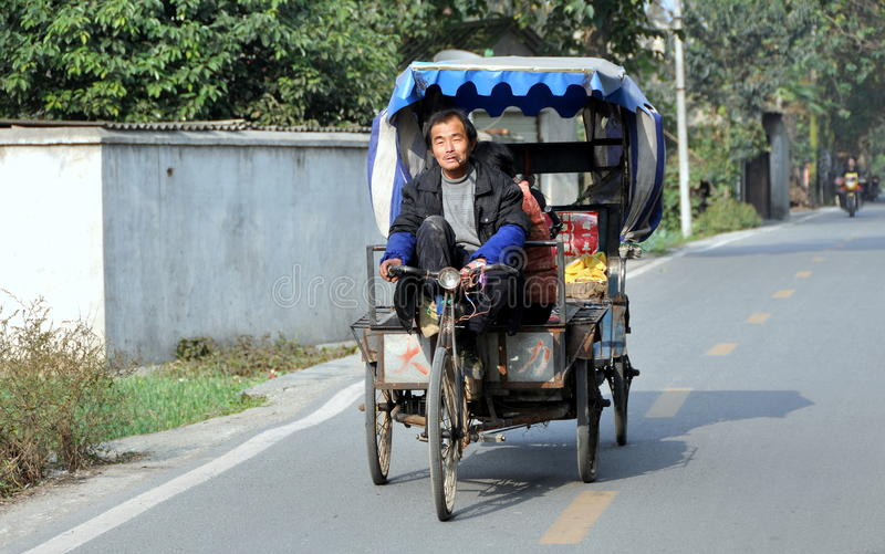 Pengzhou, China: Pedicab And Driver Editorial Stock Image