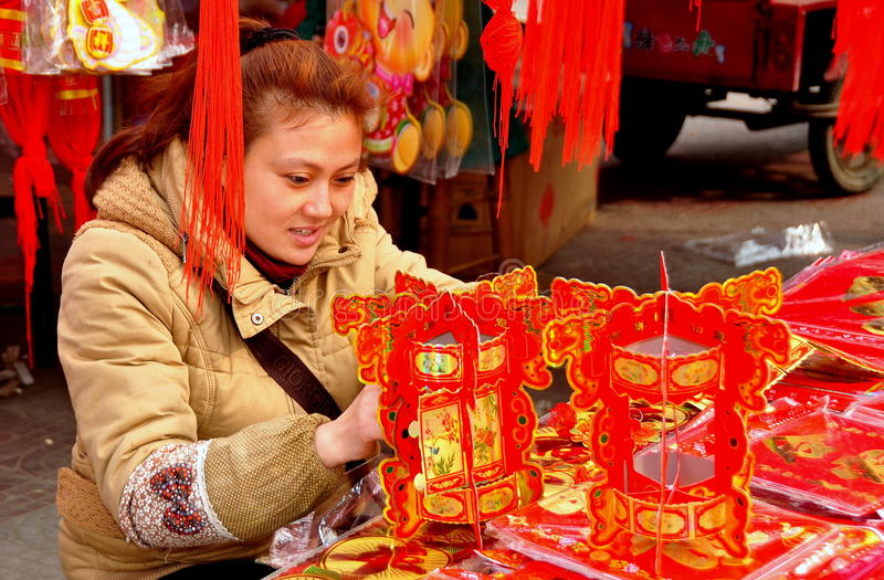 Download Pengzhou, China: Woman With Chinese New Year Decorations Editorial Photo - Image: 29019641