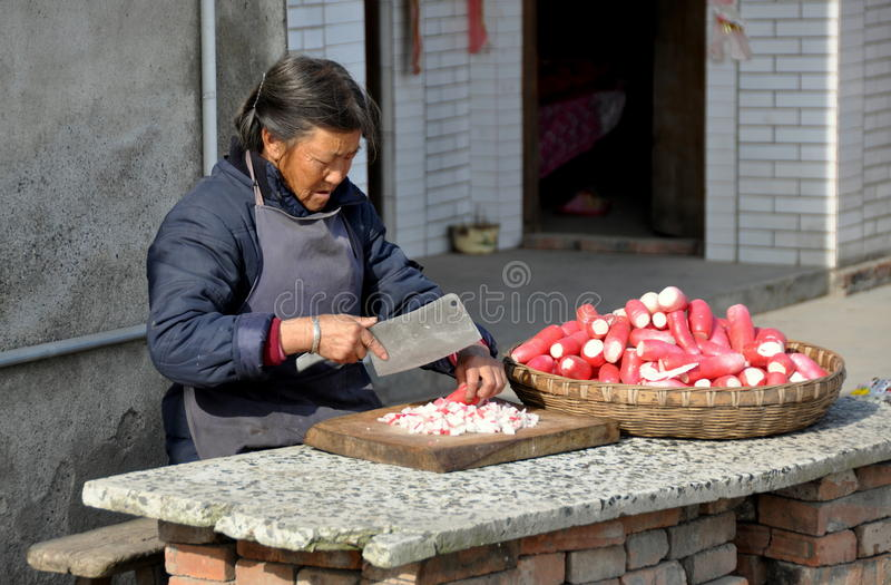 Download Pengzhou, China: Woman Chopping Radishes Editorial Stock Photo - Image: 17348888