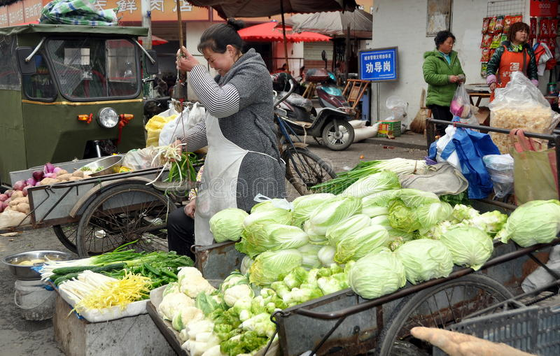 Pengzhou, China: Woman Selling Fresh Produce royalty free stock image