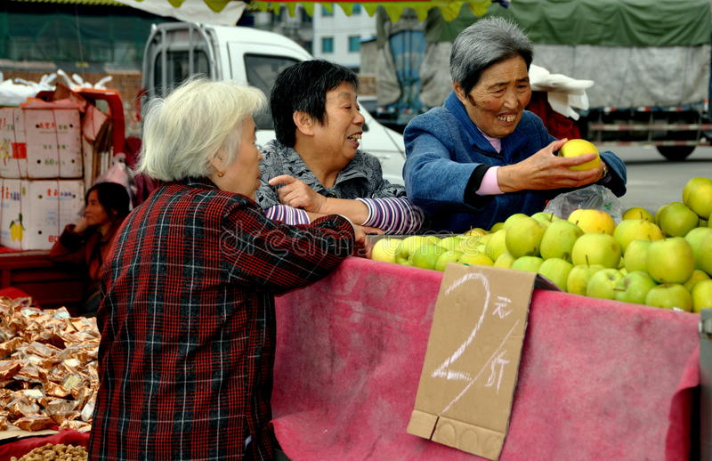 Download Pengzhou, China: Women Buying Apples Editorial Stock Photo - Image: 27898833