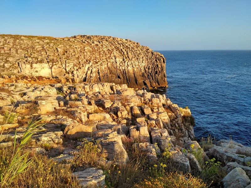 Peniche ocean cliffs near Cabo Carvoeiro in sunset light royalty free stock photography