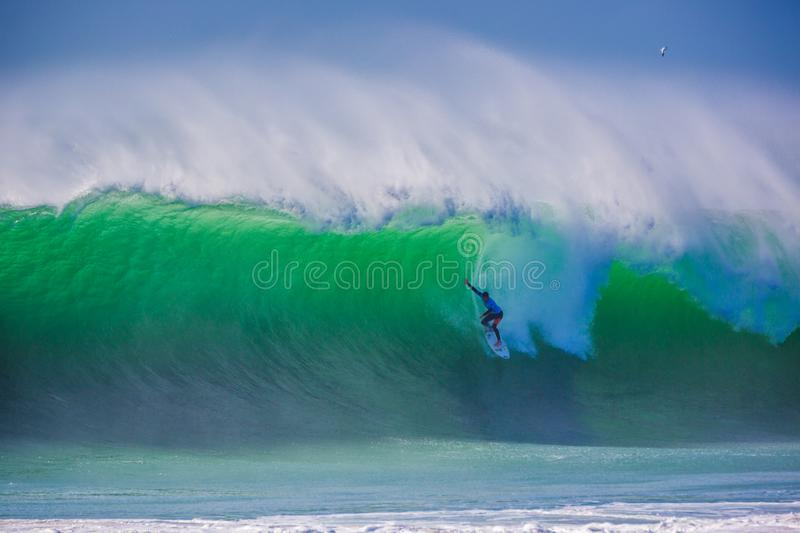 Peniche, Portugal - Oct 25th 2017 - A surfer drooping a huge wave during the World Surf League`s 2017 MEO Rip Curl Pro Portugal s royalty free stock images