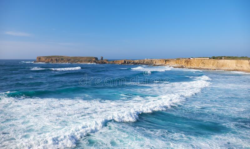 Peninsula Papoa - Peniche in Leiria district with waves of Atlantic Ocean. Portugal royalty free stock images
