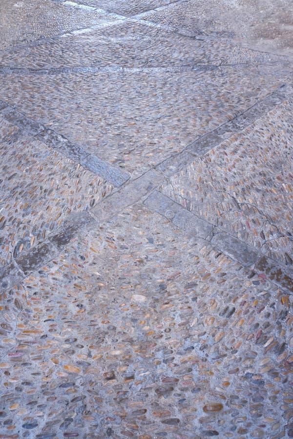 Peniscola detail of floor rolling stones mosaic in Castellon stock photo