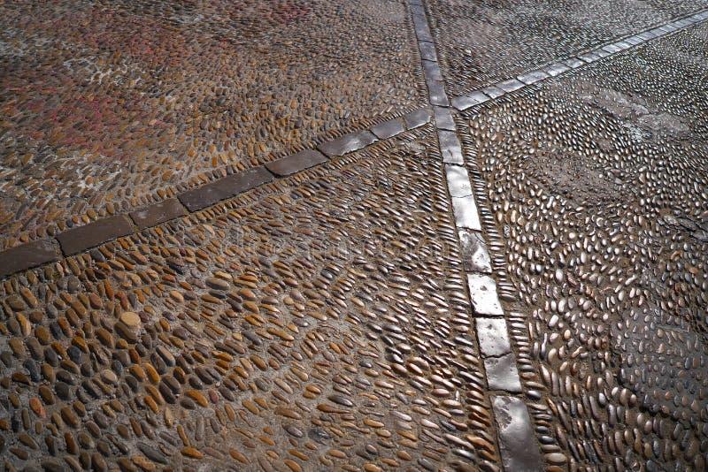 Peniscola detail of floor rolling stones mosaic stock photo