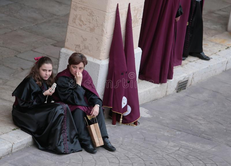 Penitents wait for the start of their Easter holy week in mallorca stock images