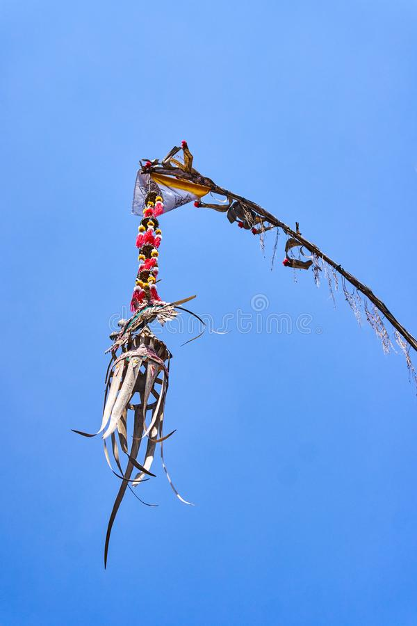 Penjor - Symbol Thanks and Greatness of God view. On blue sky stock photo