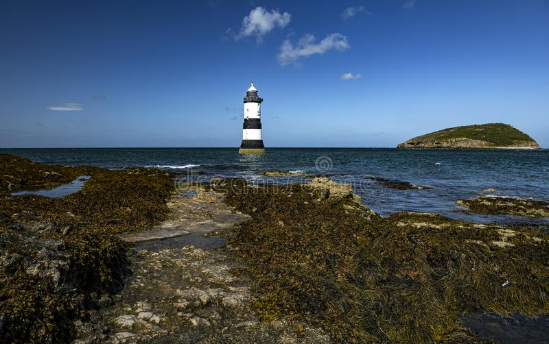 Penmon Lighthouse. Looking out at Penmon lighthouse along the Welsh coastline.  royalty free stock photo