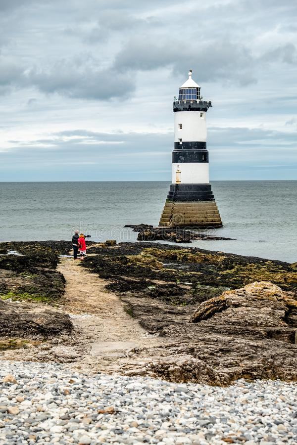 The Penmon point lighthouse is located close to Puffin Island on Anglesey, Wales - United Kingdom.  stock images