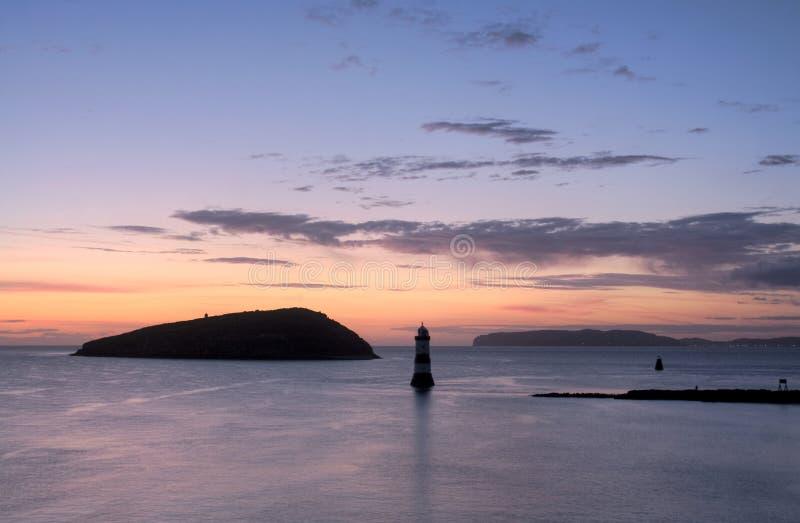 Penmon Punkt-Sonnenaufgang lizenzfreie stockfotografie
