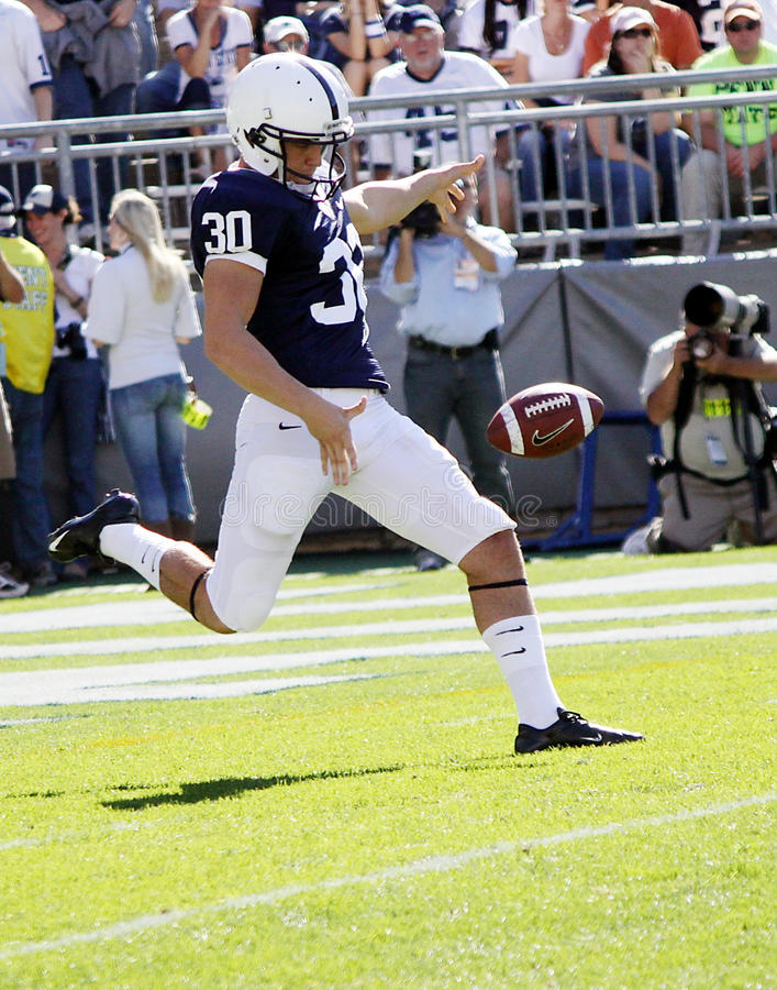 Penn State punter Anthony Fera. Drops the ball to punt royalty free stock photos