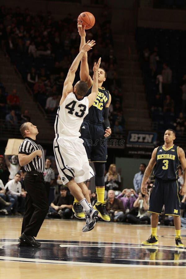 Penn State s Ross Travis and Michigan s Jordan Morgan jump