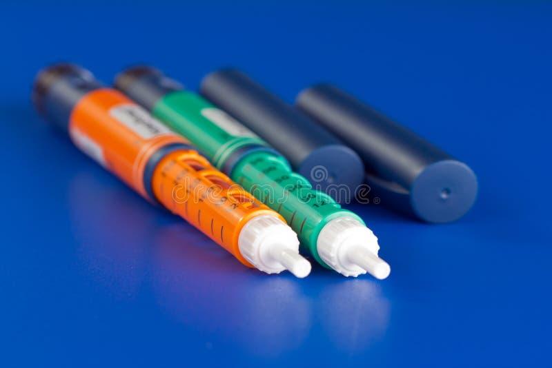 Penna della siringa delle due insuline immagine stock