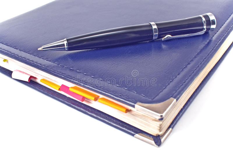 Penna e taccuino blu immagine stock libera da diritti
