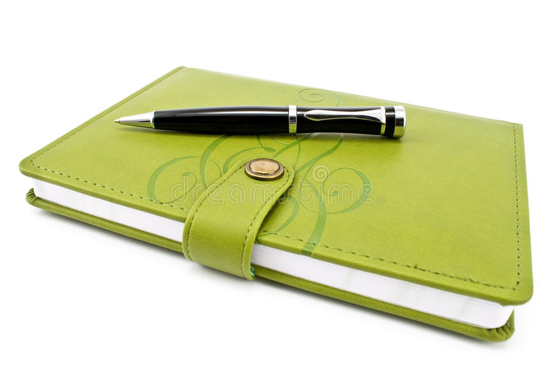 Penna e taccuino verde immagini stock libere da diritti