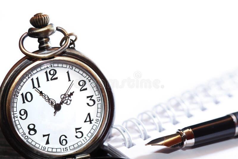 Penna ed orologio immagini stock