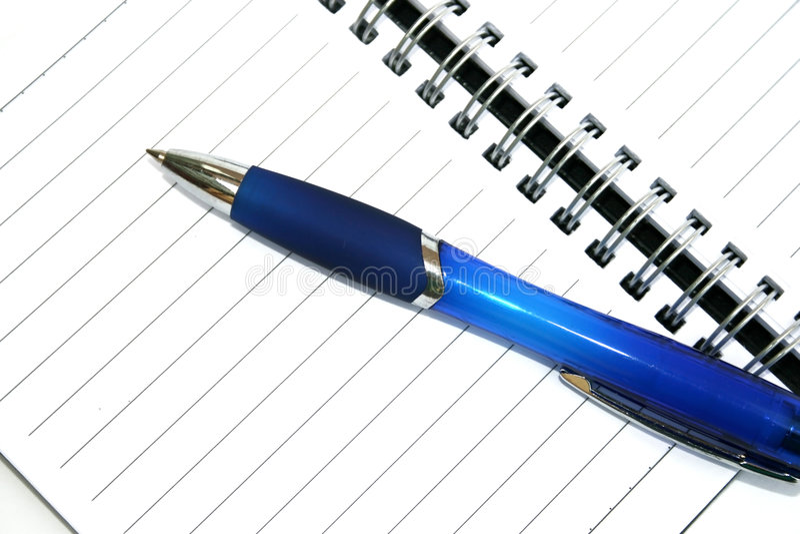 penna för anmärkning för blå bok fotografering för bildbyråer