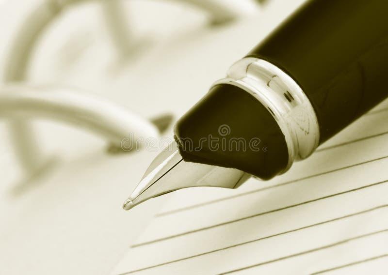 Penna su notegook fotografie stock