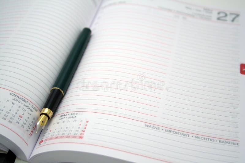 Penna sul calendario immagine stock libera da diritti