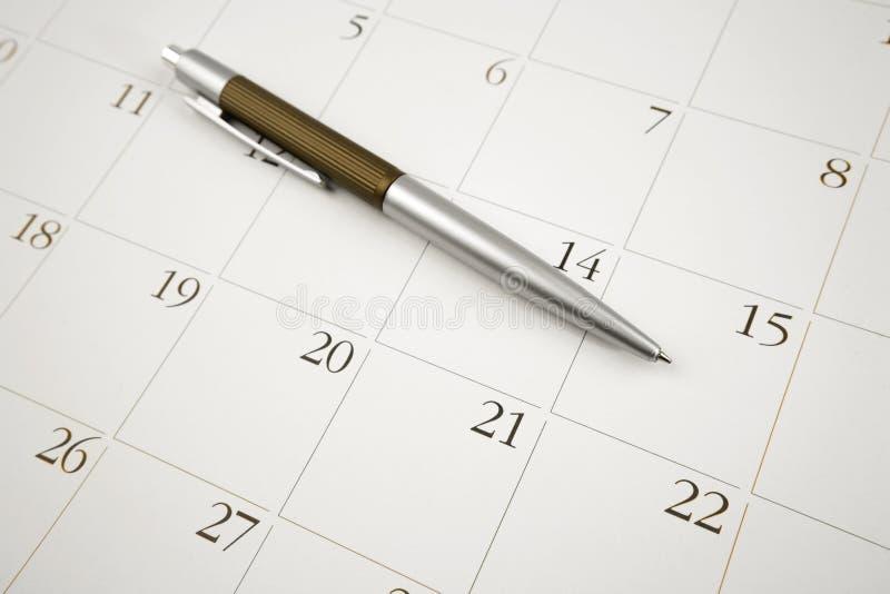 Penna sul calendario fotografia stock