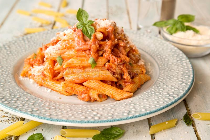 Penne in creamy tomato sauce with sour cream and Voka. Penne alla vodka - Penne in creamy tomato sauce with sour cream and Voka royalty free stock photo