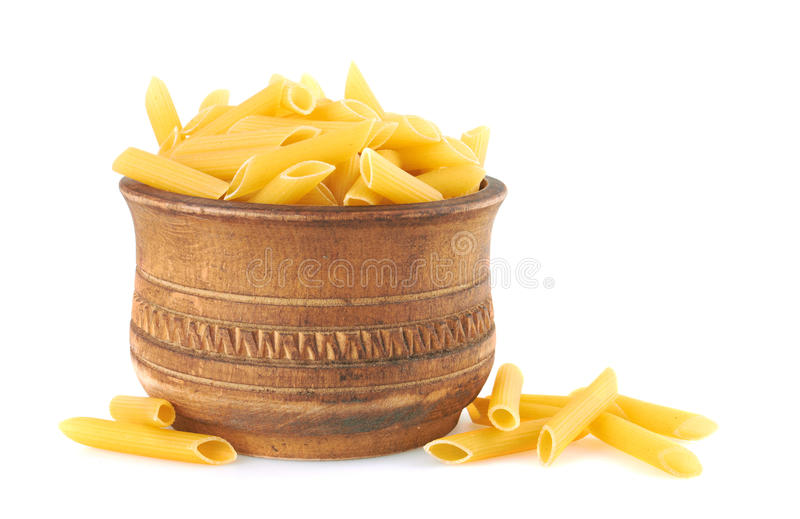 Penne italian pasta in wood bowl royalty free stock images