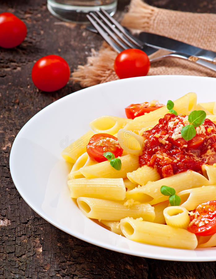 Penne pasta. With bolognese sauce, parmesan cheese and basil royalty free stock photos