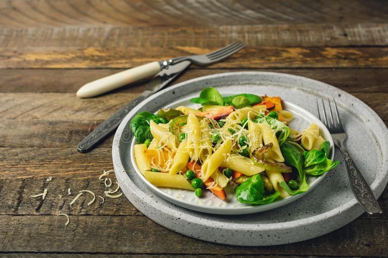 Penne pasta with grilled vegetables stock images