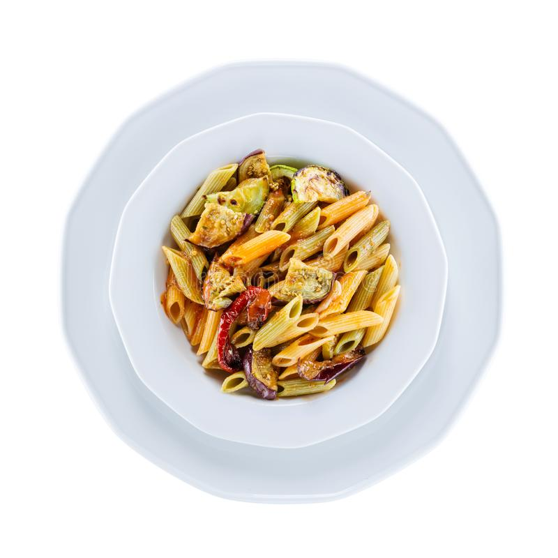 Penne pasta with grilled vegetables over white, with path royalty free stock images
