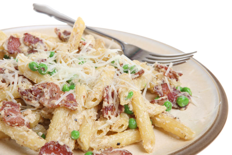 Penne Pasta with Pancetta, Ricotta and Peas stock photo