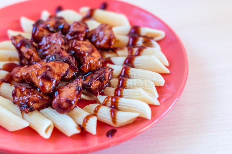 Penne with Teriyaki Chicken stock photo