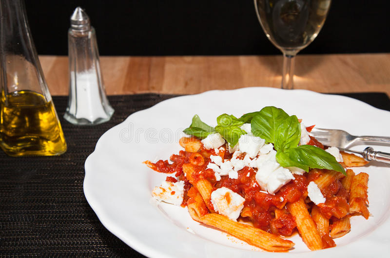 Download Penne And Tomatoe Sauce, With Cheese And Basil. Stock Photo - Image of italian, dinner: 32512882