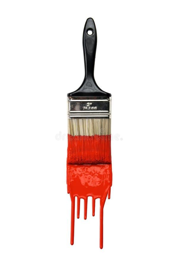 Pennello con vernice rossa fotografie stock libere da diritti