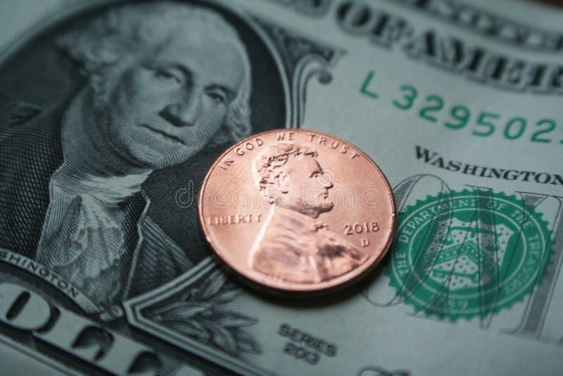 Penny With One Dollar 2018 imagen de archivo libre de regalías