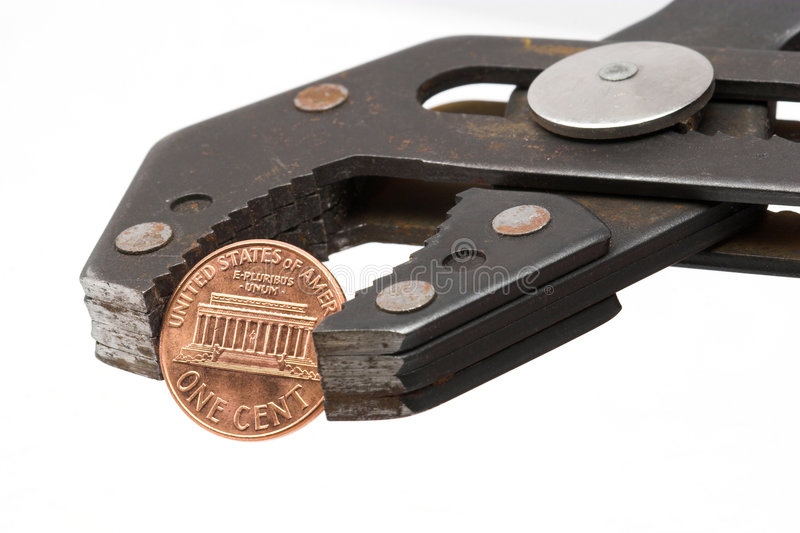 Penny Pincher 1. Macro of penny pinching tool royalty free stock photo