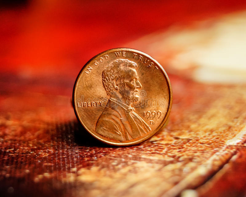Penny on red oil painting stock images