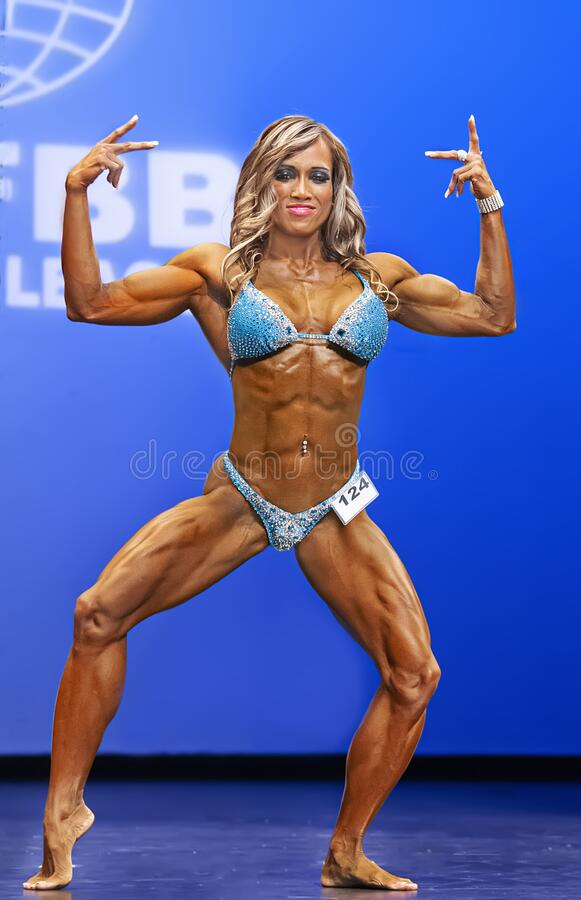 Free Penpraghai Tiangngok Flexing At 2012 NY Women`s Physique Contest Royalty Free Stock Images - 211032869