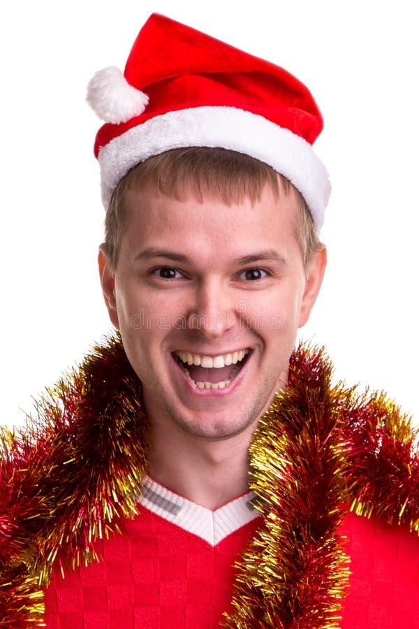 Pensée pour des idées de cadeau de Noël Type de sourire drôle avec un chapeau et une tresse de Santa autour du cou Portrait photographie stock libre de droits
